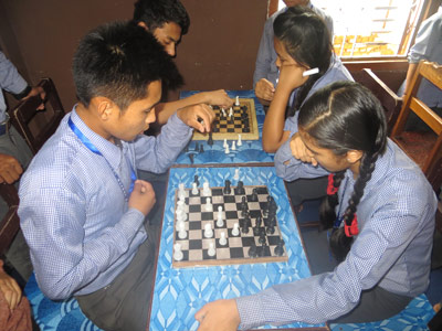 Nepali students playing chess at National Bethel Academy