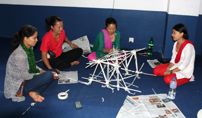 Nepali women working on a craft project at National Bethel Academy