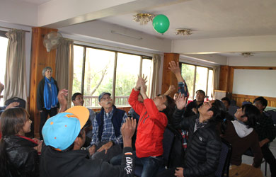 Nepali students and mentors playing balloon game